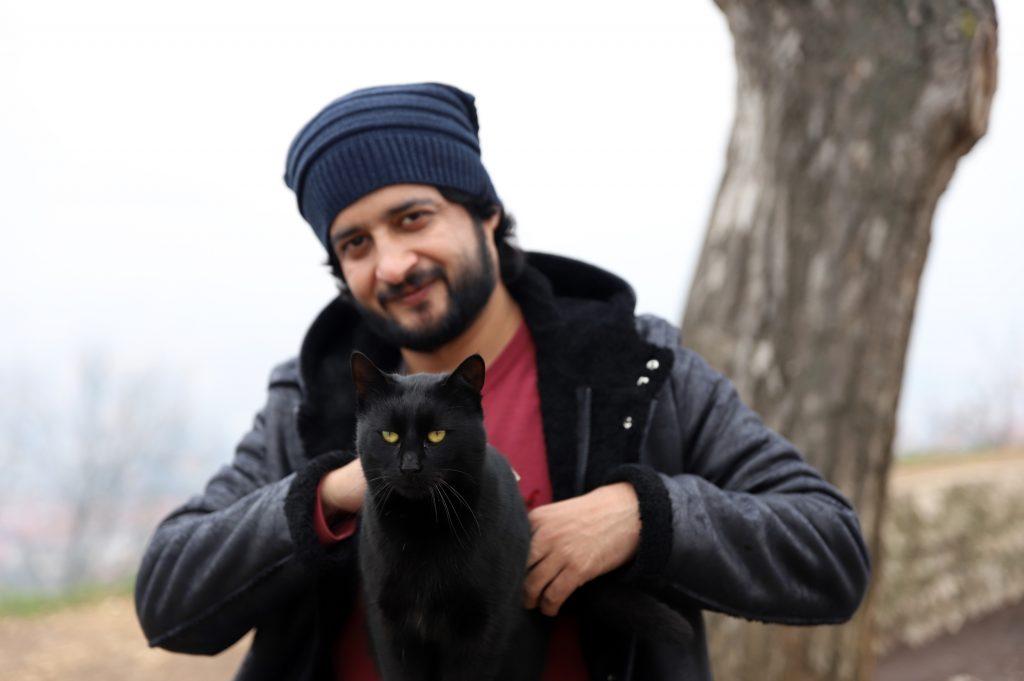 Aamir iqbal holding a cat